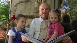 Grandpa Reads a Book to His Granddaughters 2