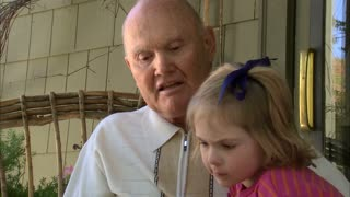 Grandpa Reads a Book to His Granddaughters 4