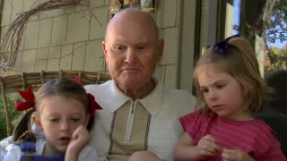 Grandpa Reads a Book to His Granddaughters 5
