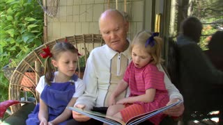 Grandpa Reads a Book to His Granddaughters