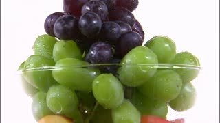Grapes in a Vase Rotating on White Background