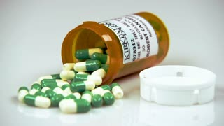 Green and White Pills in Prescription Bottle 3