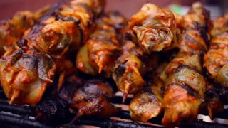 Grilled seafood on skewers. Street food. Grilling seafood on skewers and sticks. Lots of skewers with seafood on bbq party. Gourmet food from see prepared for dinner. Sea food cooked on grill