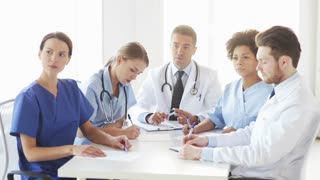 group of doctors meeting at seminar in hospital