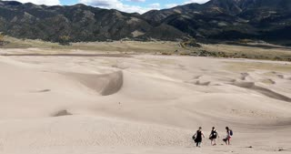 Group of friends walking in Great Sand Dunes National Park