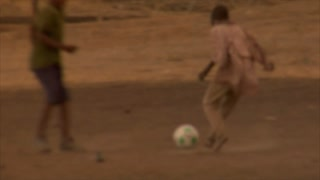 Group of Kids Playing Soccer in Africa 10