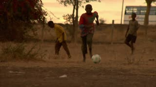 Group of Kids Playing Soccer in Africa 11