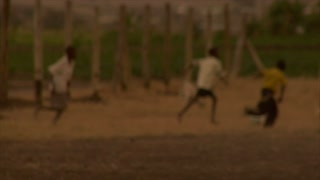 Group of Kids Playing Soccer in Africa 12