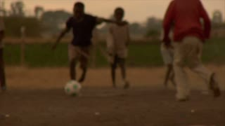 Group of Kids Playing Soccer in Africa 14