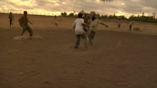Group of Kids Playing Soccer in Africa 4