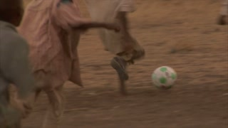 Group of Kids Playing Soccer in Africa 6