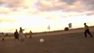 Group of Kids Playing Soccer in Africa 7