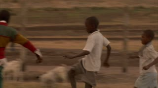 Group of Kids Playing Soccer in Africa 8