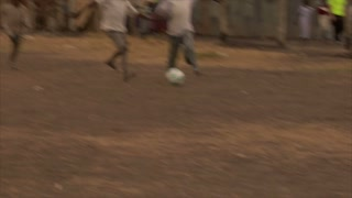 Group of Kids Playing Soccer in Africa 9