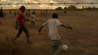 Group of Kids Playing Soccer in Africa