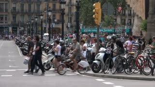 Group of Pedestrians on Crosswalk in Spain