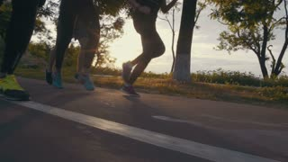 Group of people running in the park, close up, slow motion