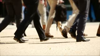 group of people walking together. slow motion. business people background