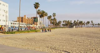 Group Walking Along California Beach Path