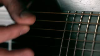 Guitarist hand and strings. Music performance. Slow motion macro video
