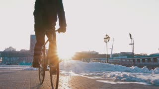 Guy riding fixed gear bike on background of the port, 4k