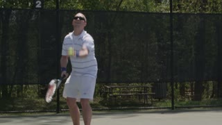 Guy Serves Tennis Ball