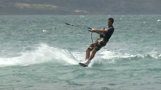 Guy Windsurfing On Beach