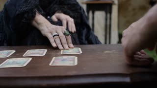 Gypsy telling a person's future using tarot cards