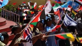 Haitian Children Wave International Flags