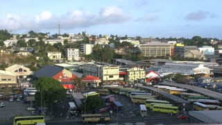 Handheld extreme wide shot of a bus station in Suva, Fiji
