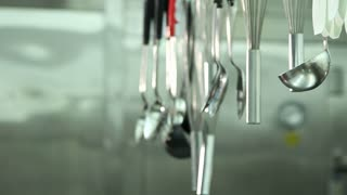 Hands Hanging Professional Cooking Tools