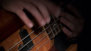 Hands Playing Bass Guitar