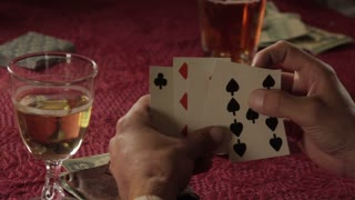 Hands Shuffling Through Cards During Western Era Poker Game