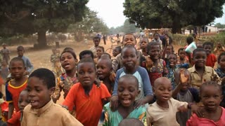Happy African Children Follow Camera And Dance