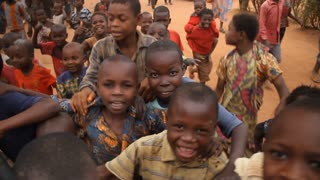 Happy African Children Follow Camera