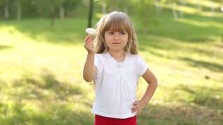 Happy child holding a mushroom