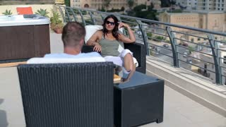 Happy couple relaxing on the terrace