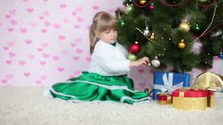 Happy girl near a Christmas tree