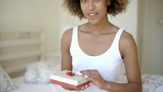 Happy Young Woman Open Gift Box In Bedroom