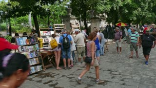 Havana, Cuba. Travel, Caribbean holidays, vacation, Cuban tourism. Tourist market with shops, fair with stalls selling souvenirs, gifts, gadgets, handicrafts, objects, posters, books. People shopping