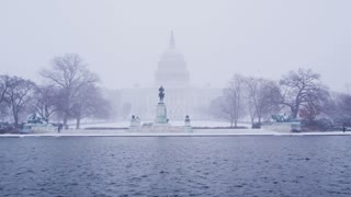 Hazy Blizzard Around Capitol Building And Reflection Pool