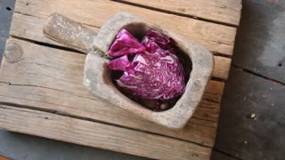 Healthy food. Portion of Red Coleslaw on vintage wooden table.