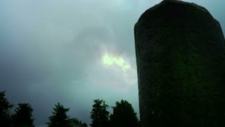 Heavy Cloud Cover And Ancient Column
