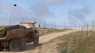 Heavy Dump Truck Hauling Dirt Uphill