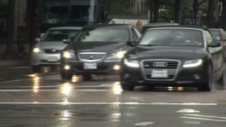 Heavy Traffic Drives Through Rainy DC Street 1
