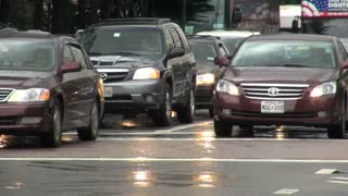 Heavy Traffic Drives Through Rainy DC Street 2