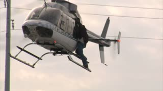 Helicopter Flies As Stunt Man Clings To Side