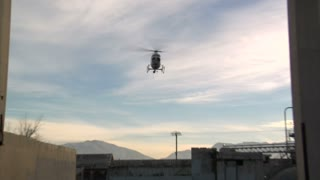 Helicopter Lands In Industrial Area