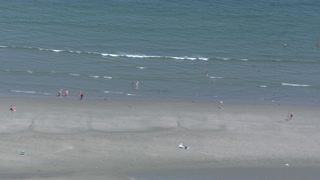 Helicopter Shot Of Beach Goers On The Break Line
