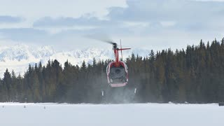 Helicopter Taking Off From Icy Ground